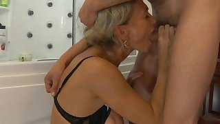 Smoking hot milf surprises her boytoy in the shower